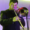 Lowell Winterfest opening night. Tim Green of Lowell plays trombone with the Squires of Soul. (SUN Julia Malakie)