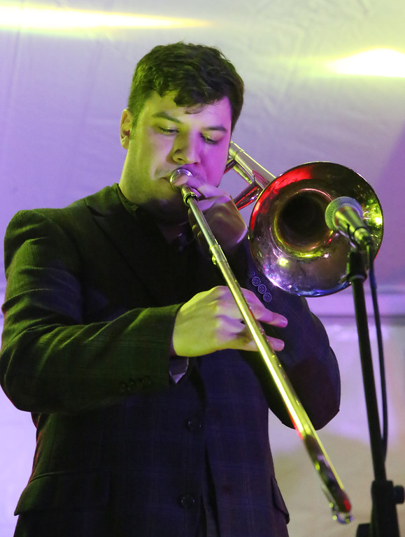 . Lowell Winterfest opening night. Tim Green of Lowell plays trombone with the Squires of Soul. (SUN Julia Malakie)