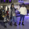 Lowell Winterfest opening night. Jaan Mugalu, 4, her cousin Isabel Kayanja, 13, and their grandmother Vida Nyarko, all of Lowell, at the skating rink at JFK Plaza. (SUN Julia Malakie)