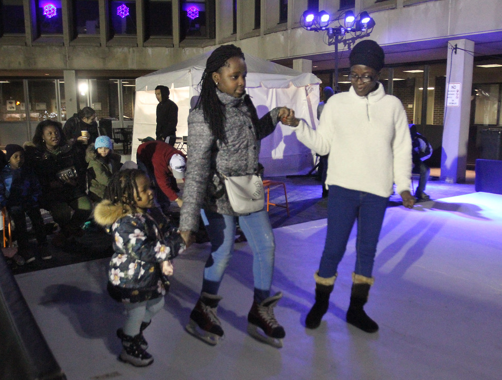 . Lowell Winterfest opening night. Jaan Mugalu, 4, her cousin Isabel Kayanja, 13, and their grandmother Vida Nyarko, all of Lowell, at the skating rink at JFK Plaza. (SUN Julia Malakie)
