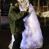 Lowell Winterfest opening night. Snow Maiden on stilts Sasha Gaulin of Worcester poses for a photo with Sean Kelley of Lowell. (SUN Julia Malakie)