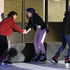 Lowell Winterfest opening night. From left, Nichelle  DeJesus, 13, Lilah Oertel, 13, and Alysandra Cleary, 14, all of Lowell, on the artificial ice skating rink at JFK Plaza. (SUN Julia Malakie)