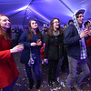 Lowell Winterfest opening night. From left, friends Ashley Hillson, Briana McGrade, Rebecca Tourville and Keith Boisvert, all of Dracut, at the JFK Plaza music tent, where the Squires of Soul were performing. (SUN Julia Malakie)