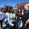 "Current and former Lowell High students, interfaith organizations, and Middlesex Sherriff's Department and Lowell Police hold 3rd annual ""Safer Homes, Safer Community: Gift Cards for Guns"" exchange he Community Christian Academy parking lot. From left, Carla Duran (LHS '16) of Lowell, Lowell High seniors Lynsey Philippe, 17, and Areej Jameel, 18, and Lowell Police school resource officer Mindy Dower.  (SUN/Julia Malakie)"