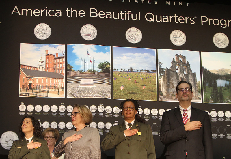 Launch and coin exchange for the Lowell quarter, representing Massachusetts as the 46th coin in the US Mint's America the Beautiful Quarters Program. From left, Lowell National Historical Park superintendent Celeste Bernardo, former congresswoman Niki Tsongas, NPS Northeast Region deputy director Rosalyn Fennell, and Marc Landry, acting associate director of the Numismatic and Bullion Directorate, US Mint. (SUN/Julia Malakie)
