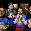 Launch and coin exchange for the Lowell quarter, representing Massachusetts as the 46th coin in the US Mint's America the Beautiful Quarters Program. Bartlett School 4th graders, from left, Divine Verdier, 9, Ryan Dias, 10, Kylees Roman, 10, and Anjali Feliciano, 10, with the quarters ther received. Everyone under 18 got a free quarter. (SUN/Julia Malakie)