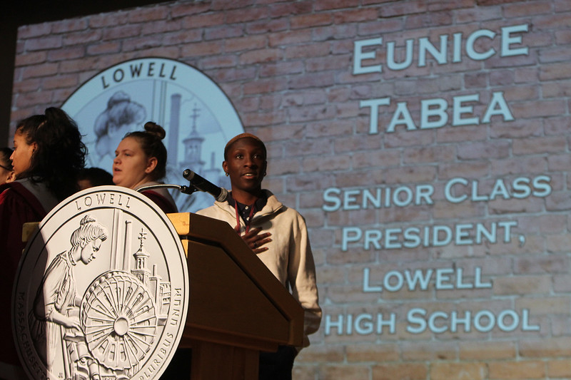 Lowell High senior class president Eunice Tabea leads the Pledge of Allegiance at launch and coin exchange for the Lowell quarter, representing Massachusetts as the 46th coin in the US Mint's America the Beautiful Quarters Program. (SUN/Julia Malakie)