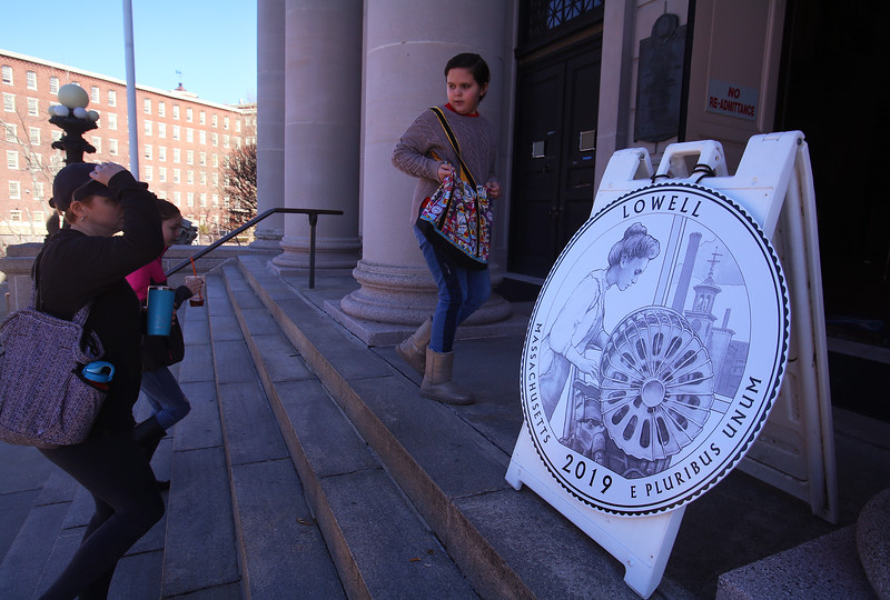 People arrive for launch and coin exchange for the Lowell quarter, representing Massachusetts as the 46th coin in the US Mint's America the Beautiful Quarters Program. (SUN/Julia Malakie)