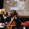 "Launch and coin exchange for the Lowell quarter, representing Massachusetts as the 46th coin in the US Mint's America the Beautiful Quarters Program. Sophomore Metsni Kitolo plays cello as the Lowell High School Band plays ""Mills on the Merrimack"" to accompany a video about Lowell history. (SUN/Julia Malakie)"