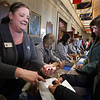 Launch and coin exchange for the Lowell quarter, representing Massachusetts as the 46th coin in the US Mint's America the Beautiful Quarters Program. Jeanne D'Arc Credit Union AVP and regional branch manager Maura McVilvery of Lowell exchanges cash for new Lowell quarters. (SUN/Julia Malakie)