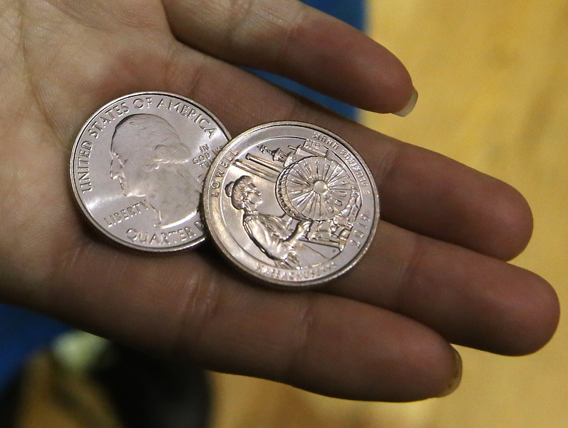 Launch and coin exchange for the Lowell quarter, representing Massachusetts as the 46th coin in the US Mint's America the Beautiful Quarters Program. New quarters. Everyone under 18 got a free quarter. (SUN/Julia Malakie)