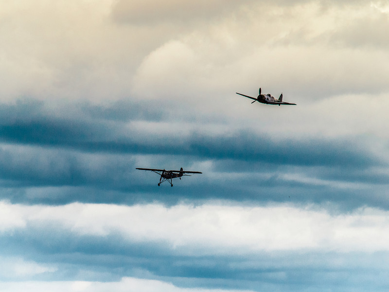 Fieseler Fi 156 Storch and Focke-Wulf Fw-190 A-5 together in flight at Luftwaffe Fly Day hosted by the Flying Heritage Collection at Paine Field in Everett, WA, August 17, 2013.