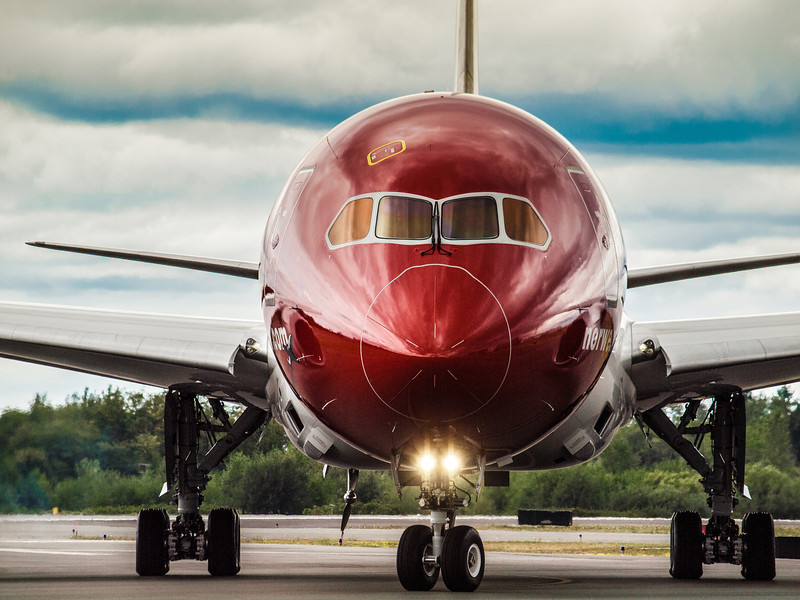 Stunning new Norwegian 787-B Dreamliner being tested before delivery on the Paine Field runway during Luftwaffe Fly Day, August 17, 2013.  Look at that reflective metallic red paint.