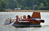 """Mason Keefer (left) his brother Cole (middle) and his cousin Paige Gengler (right) pilot their boat """"Dusty Crophopper"""" in Lunenburg's Annual Cardboard Boat Race on Lake Whalom. They were the sole competitors and ironically enough, the winners. SENTINEL&ENTERPRISE/ JIM MARABELLO"""