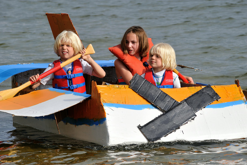 """Cole Keefer (left) his brother Mason (right) and their cousin Paige Gengler (center) pilot their boat """"Dusty Crophopper"""" in Lunenburg's Annual Cardboard Boat Race on Lake Whalom. They were the sole competitors and ironically enough, the winners. SENTINEL&ENTERPRISE/ JIM MARABELLO"""