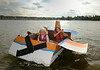 """Mason Keefer (front) his brother Cole (obscured-rear) and his cousin Paige Gengler pilot their boat """"Dusty Crophopper"""" in Lunenburg's Annual Cardboard Boart Race on Lake Whalom. They were the sole competitors and ironically enough, the winners. SENTINEL&ENTERPRISE/ JIM MARABELLO"""