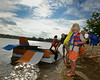 """""""Captain"""" Mason Keefer disembarks from """"Dusty Crophopper"""" winner of Lunenburg's Annual Cardboard Boat Race on Lake Whalom. He along with his brother Mason and cousin Paige Gengler were the sole competitors this year. SENTINEL&ENTERPRISE/ JIM MARABELLO"""