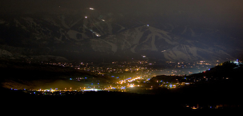 Steamboat at night with snow cats