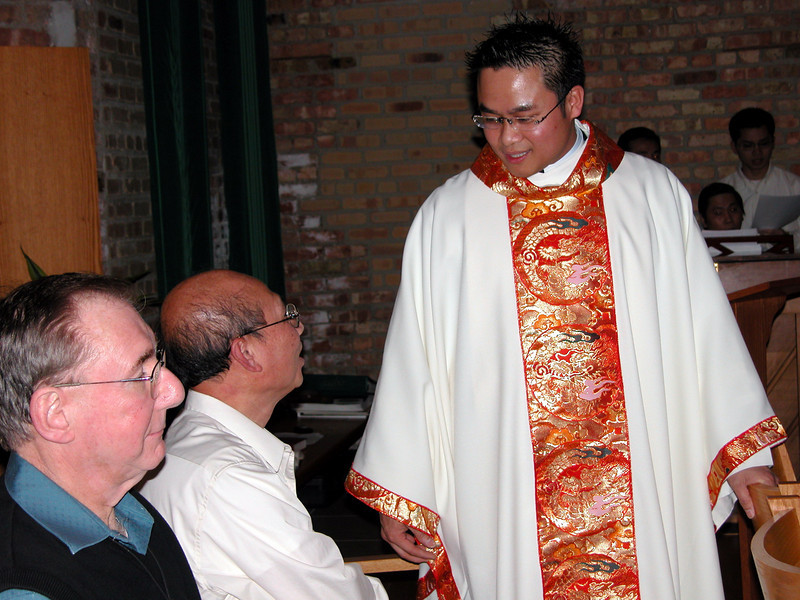 Fr. Thi Pham prior to Mass.