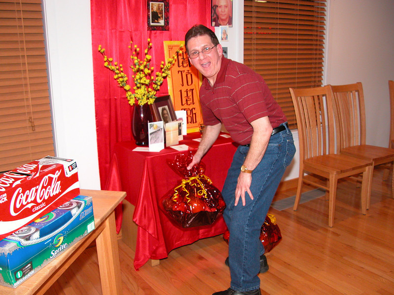 The gifts of fruit and chocolate make their way upstairs after Mass.  Fr. Mark gets things ready for the party.
