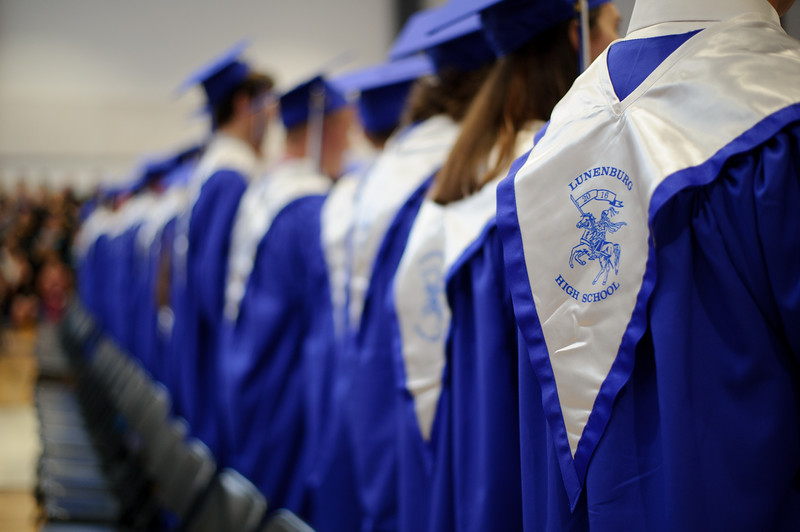"5/26/16 LUNENBURG-- Lunenburg graduates facing guests to sing their class song ""My Wish"" by the Rascal Flatts during Fridays graduation ceremony in Lunenburg High School's new building.  Sentinel & Enterprise photo/Jeff Porter"