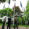 5/29/16 LUNENBURG-- Lunenburg Police Officers and the color guard stand with flag that was raised before the start of Sundays Memorial Day ceremony at the Eagle House Senior Center in Lunenburg.  Sentinel & Enterprise photo/Jeff Porter