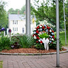5/29/16 LUNENBURG-- A wreath is placed at the base of the flag for Sundays Memorial Day ceremony at the Eagle House Senior Center in Lunenburg.  Sentinel & Enterprise photo/Jeff Porter