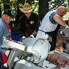 Doug Gustafson has been producing our roast beef for as long as I've been attending the picnic and it's always worth lining up for. Here a couple of Lion Feeders help with the slicing while a crowd gathered to the right, awaiting scraps and ends of the beef.