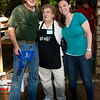 Jeff Kok, master salmon cooker and LTII employee hugs Betty Bevers, the ice cream cup lady shown here with Betty's granddaughter, Elise.