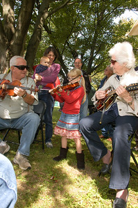 Photos by Weldon Photography Jamming at the 30th annual Lyons Fiddle Festival held at Lyons Community Park in Lyons on Sept. 15.