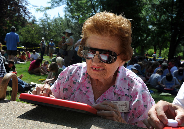 "Laverne Johnson was among 372 people who broke a world record during the Etch-A-Sketch Sketch A Palooza during Lyons Good Old Day.<br /> Hundreds made there way to downtown Lyons for the 35th Annual Lyons Good Old Days on Saturday.<br /> For a video and more photos of Good Old Days, go to  <a href=""http://www.dailycamera.com"">http://www.dailycamera.com</a>.<br /> Cliff Grassmick / June 25, 2011"