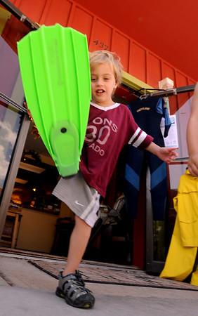 "Nico Kutrumbos, 4, was shopping for the right fin in downtown Lyons<br /> Hundreds made there way to downtown Lyons for the 35th Annual Lyons Good Old Days on Saturday.<br /> For a video and more photos of Good Old Days, go to  <a href=""http://www.dailycamera.com"">http://www.dailycamera.com</a>.<br /> Cliff Grassmick / June 25, 2011"