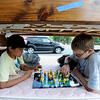 "Nate Christy, left, and Dalton Simpson, play chess with a Simpson chess set bought at the Boy Scouts garage sale at Lyons Good Old Days. The bunk beds were sold too.<br /> Hundreds made there way to downtown Lyons for the 35th Annual Lyons Good Old Days on Saturday.<br /> For a video and more photos of Good Old Days, go to  <a href=""http://www.dailycamera.com"">http://www.dailycamera.com</a>.<br /> Cliff Grassmick / June 25, 2011"