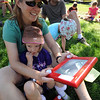 "Donna Riech and her daiughter, Lilly, 5,  were among 372 people who broke a world record during the Etch-A-Sketch Sketch A Palooza during Lyons Good Old Days.<br /> Hundreds made there way to downtown Lyons for the 35th Annual Lyons Good Old Days on Saturday.<br /> For a video and more photos of Good Old Days, go to  <a href=""http://www.dailycamera.com"">http://www.dailycamera.com</a>.<br /> Cliff Grassmick / June 25, 2011"
