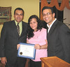 Paula Bronzoni receiving certificate of 5 years of service