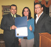Filomena Fagundes receiving certificate of 10 years of service to MAPS
