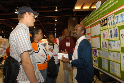 EB2007:  Peer Mentor, Dr. Tracy Womble, looks on as his MARC Student Day mentees participate in a poster presentation. (AAA Poster Presenter)