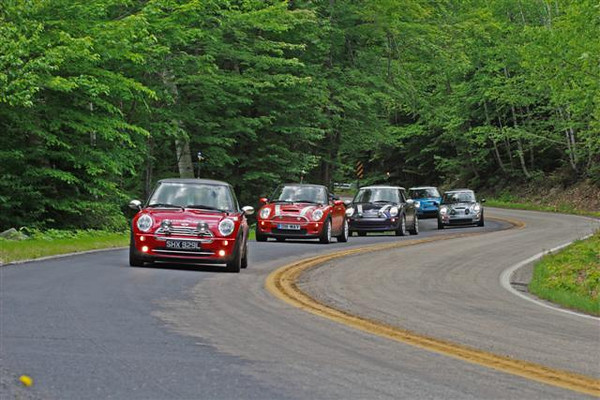 MINI Coopers carve through the twisites on Bear Notch Road.