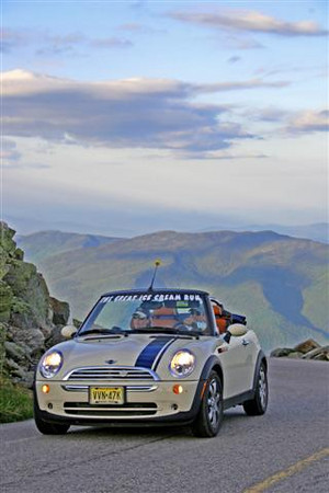 A MINI Cooper rounds the final turn at the summit of Mt. Washington.