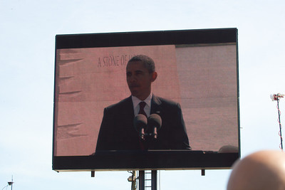 Obama addressed the crowd on video from the Monument a short distance away