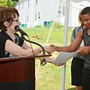 Vladimir Reynoso receives a certificate from Summer Jobs Coordinator Deb Namvar during the recognition luncheon to honor sponsors, employers, and participants of MOC's Jobs4Youth summer program on Thursday afternoon. SENTINEL & ENTERPRISE / Ashley Green