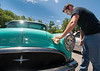 Dean Osgood of Fitchburg wipes down his 1954 Buick Special at the Father's Day Car Show at Monty Tech in Fitchburg SENTINEL & ENTERPRISE/JIM MARABELLO