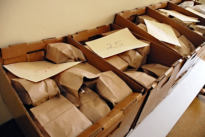 06-07-12  --must summer lunch 02--  Boxes containing 25 sack lunches each wait to be loaded into volunteer drivers cars on Thursday morning.  STAFF/LAURA MOON.