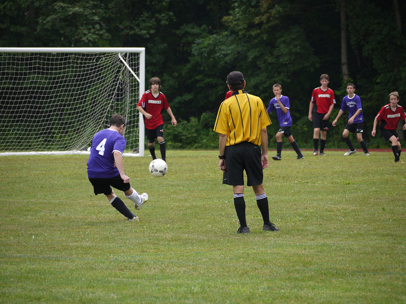 Trying to kick into the goal (missed).