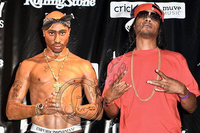 HOLLYWOOD, CA - JUNE 16:  MC / producer DJ Quik (R) attends the launch of the wax figure of music icon Tupac Shakur at Madame Tussauds on June 16, 2012 in Hollywood, California.  (Photo by Chelsea Lauren/WireImage)