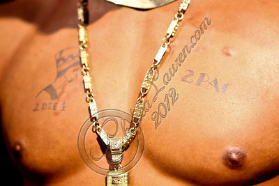 HOLLYWOOD, CA - JUNE 16:  A view of the new wax figure of music icon Tupac Shakur (tattoo detail) at Madame Tussauds on June 16, 2012 in Hollywood, California.  (Photo by Chelsea Lauren/WireImage)