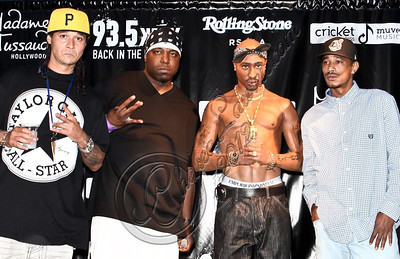 HOLLYWOOD, CA - JUNE 16:  Recording artists Bone Thugs-n-Harmony pose at the launch of the wax figure of music icon Tupac Shakur at Madame Tussauds on June 16, 2012 in Hollywood, California.  (Photo by Chelsea Lauren/WireImage)