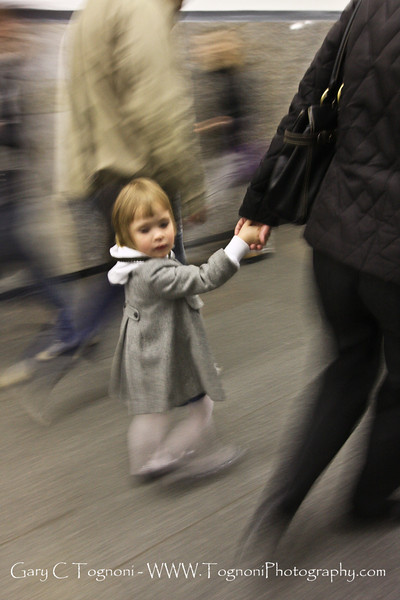 """Rush Hour"" I caught this little girl looking back during rush hour in a St Petersburg subway station."