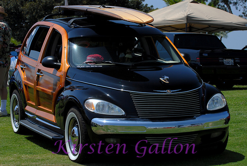 Dark blue Woody Pt Cruiser.  This one is for sale people.  Call the number on the back window if you are interested.