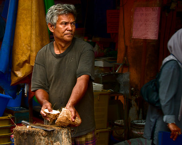 Honorable Mention in the Working People category for 2011. A coconut vendor at the market in Alor Gajah, Malaysia.